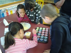 we had to pour our mixture into tiny cupcake holders - it was tricky