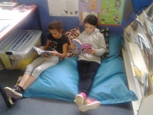 These two girl cannot get enough of reading!