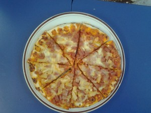 We had three pizzas and we had to cut each one into eights so everyone in our class got an equal piece
